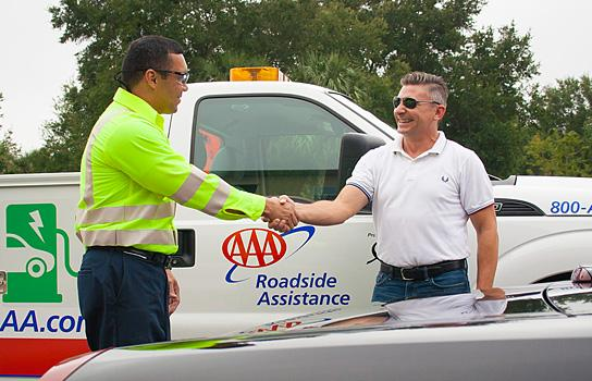 AAA Minneapolis tow truck driver delivering roadside assistance in Hennepin County MN