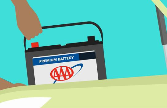 AAA car battery being installed by roadside assistance in Minneapolis MN